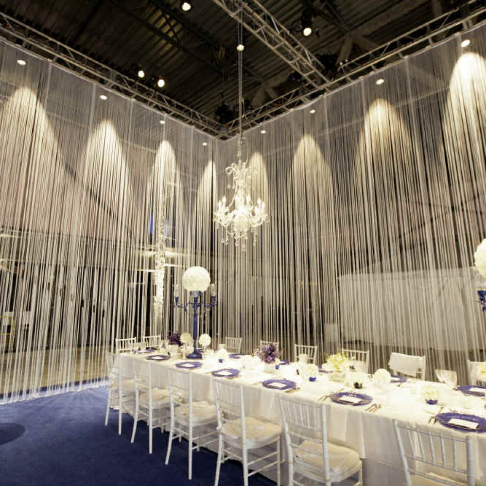 Fringe curtain event design