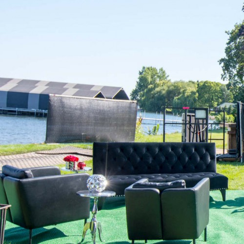 Cambria 2016 black lounge by water