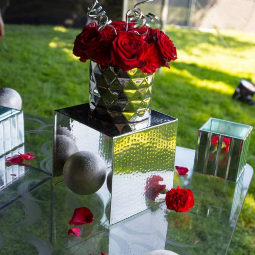 Cambria 2016 silver vases on glass table